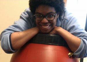 Chrissy grinning over our rain barrel