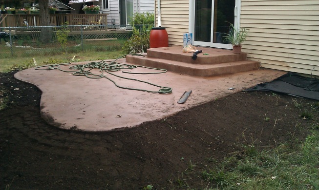 After landscapting with soil, putting down weed blocker and new borders