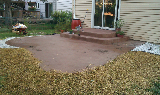 Grass growing, beds planted and marble chips put down