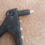 Rivet gun with rivet inserted